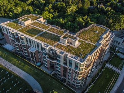 Aerial photos of a beautiful green roof on a luxury condo.